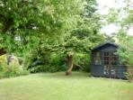 The summerhouse at the bottom of the half acre garden