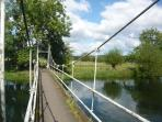 Foot suspension bridge over the water meadows on the Avon Valley Footpath (5 mins walk)