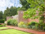 Traditional Victorian walled gardens including pleached pear trees and a fruit orchard