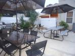 Back yard patios with view to Hot Tub enclosure and stairs to 2nd floor