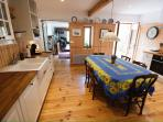 Bright airy light filled kitchen opens onto a courtyard. Table seats 8.