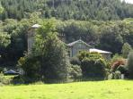 Coed y Celyn Hall in the summer. On The banks of the River Conwy