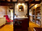 Washbasin and bathroom furniture with hair dryer, soap and shampoo
