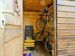And next door in the same Pavilion, the storage with 2 bicycles for adults, outoors games and chairs