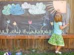 Huge chalk board in the garden for hours of fun!