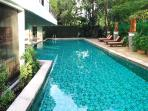 Big outdoor pool surrounded by greenery space