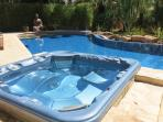Hot tub next to the pool