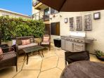 Great back yard for relaxing or to grill.  Handy outdoor shower to rinse off.