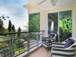 Enjoy the ocean and mountain view from the cozy balcony veranda