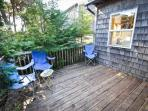 Semi private back deck with folding chairs.