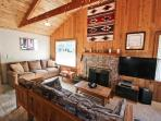 Living room with wall mounted flat screen TV/Blu-Ray DVD, surround sound, wood burning fireplace, two couches, two arm...