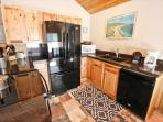 Fully equipped kitchen with a breakfast bar for four.