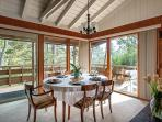 Dining Area with walls of windows and sliding doors leading out to the deck.