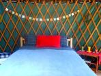 Brand new Queen bed in our 16 ft. yurt.. down comforter, wool blanket, flannel sheets,