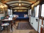 Inside the coach by day/ Lovely space with table and lots of attention to detail.