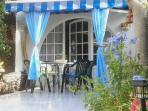 A Beautiful garden/terrace with canopy and sun drapes