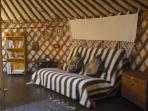 Another veiw inside the Eastern yurt, this one showing futon sofa bed used for the children.