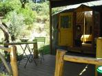 Outside deck of the Green Man yurt, a south facing and shady spot with fridge and cooking facilities