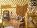 Inside the Green Man yurt, complete with ethnic hangings and handmade on-site furniture.