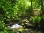 A reconditioned watermill on the walk to Pedra da Ferida waterfalls.