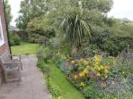 The garden in Spring - relax and enjoy a glass of wine looking over flowers and fields