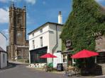 The centre of Cerne Abbas, showing the church, the beauty salon and one of the three pubs