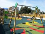 New park opposite the apartment for our younger guests.