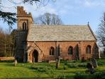 Grade II listed St John's Church is set within the walled gardens next to Kirkbride Hall