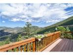 Large balcony with access from main level with forever views!