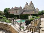 The pool with Chateau des Milandes in the background