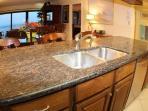 granite in the kitchen stainless steel dishwasher & refrigerator Ocean view from kitchen