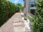 Side path leading between front & rear gardens