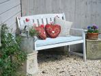 A sheltered sunny spot to relax and enjoy a good book and a glass of wine.
