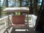 Enjoy the large front deck and take in the mountain breeze on the swing