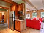 Kitchen is fully stocked with all appliances and dishes required to enjoy a home-cooked meal