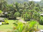 this 3/4 acre section is secluded and off the main road and leads on to Muri Beach!