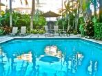 Pool Area. Chaise Loungers, Chairs, Table, Umbrella to Relax. Refresh by Pool.