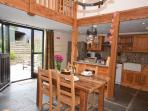 Open plan kitchen/dining area with access to the enclosed rear patio