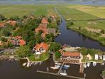the island's Woude, with one of the many beautiful harbors in a typical Dutch landscape