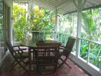 Verandah Dining with view to jungle river gorge.