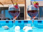Enjoy your drink at the pool side with a wonderful sea view!