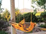 Swing on veranda.  Flatirons in background