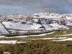Snow on Slieve Croob showing the potato drills of yesteryear