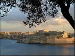 The view of St Angelos Fort and the Grand Harbour at sunset