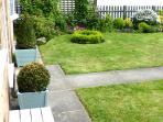 Enclosed lawned front garden ideal for children to play