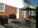 Gas BBQ with patio table for guests