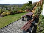 Picnic area looking out over shrub garden to Loch below