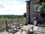 The south facing terrace overlooking the fields and valley beyond