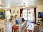 Living Room with 55' LCD TV - walks out to spacious balcony