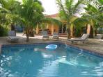 Poolside view of scuba diver villa chikitu